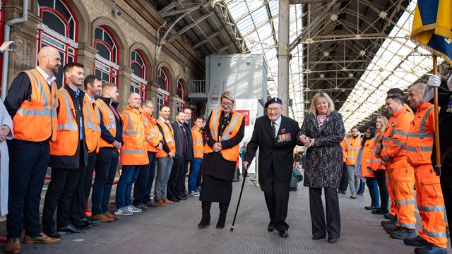 101-year-old World War II veteran's emotional send-off on Remembrance railway journey to London: Ernest Horsfall receiving a guard of honour by Network Rail staff