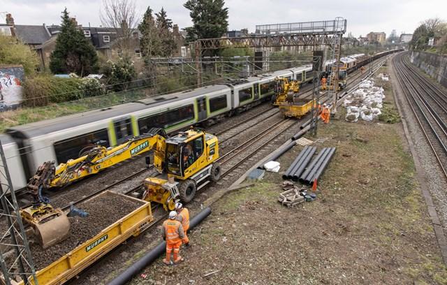 London Northwestern Railway train passing Willesden track upgrade worksite March 2021