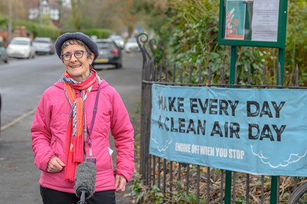 TfGM councillor stood in front of clean air banner