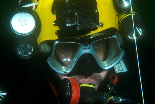 Because of the potentially inhospitable and hazardous environment, an experienced cave diver supplemented the biological survey team, providing additional safety and line-laying support. ©Graham Saunders
