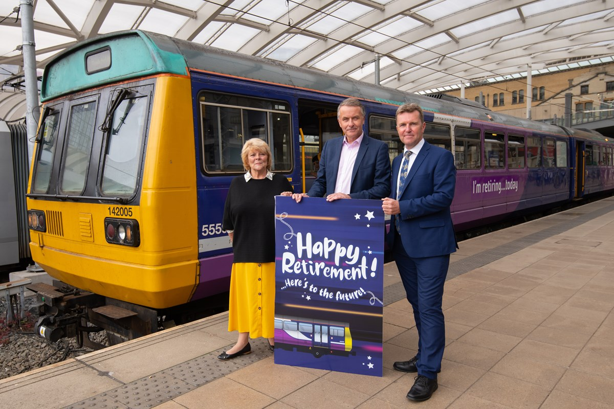 142005 - first Northern Pacer to retire: SAYING GOODBYE: (r-l) Northern MD David Brown, Transport Focus Director David Sidebottom and Cllr Doreen Dickinson, Vice Chair of TfGMC present 142005 a card to celebrate its retirement.
