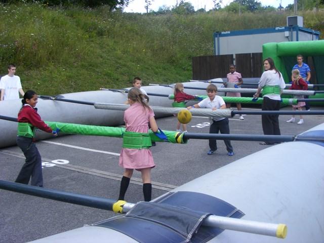 Kids playing giant table football