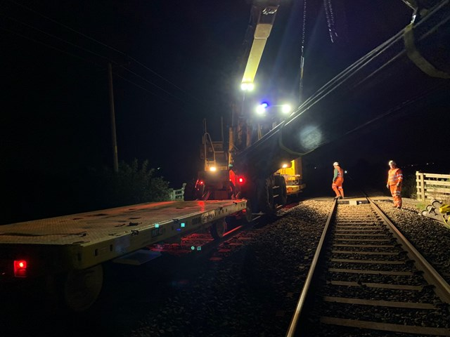 Rail mounted crane installing pipes to pump away Burscough flood water 7 October 2020