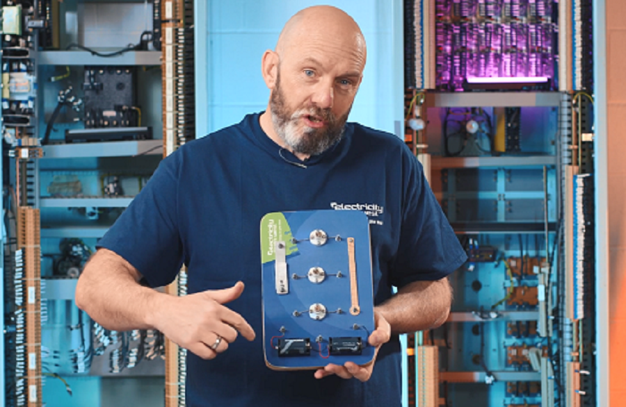 A Bright Sparks representative showing how a circuit board works