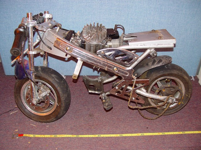 Motorcycle thrown onto the railway at Bulls Bridge: A mini-motorcycle which was thrown onto an Arriva Trains Wales service at Bulls Bridge, Shrewsbury on 7 August 2006
