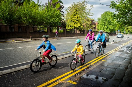 Family cycling along the Wilmslow Road Cycleway