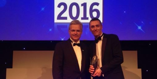 Network Rail volunteer recognised for his contribution to railway safety: Mark Carne with Tom Crosby accepting the  Judges Special Award winner at National Rail Awards 2016