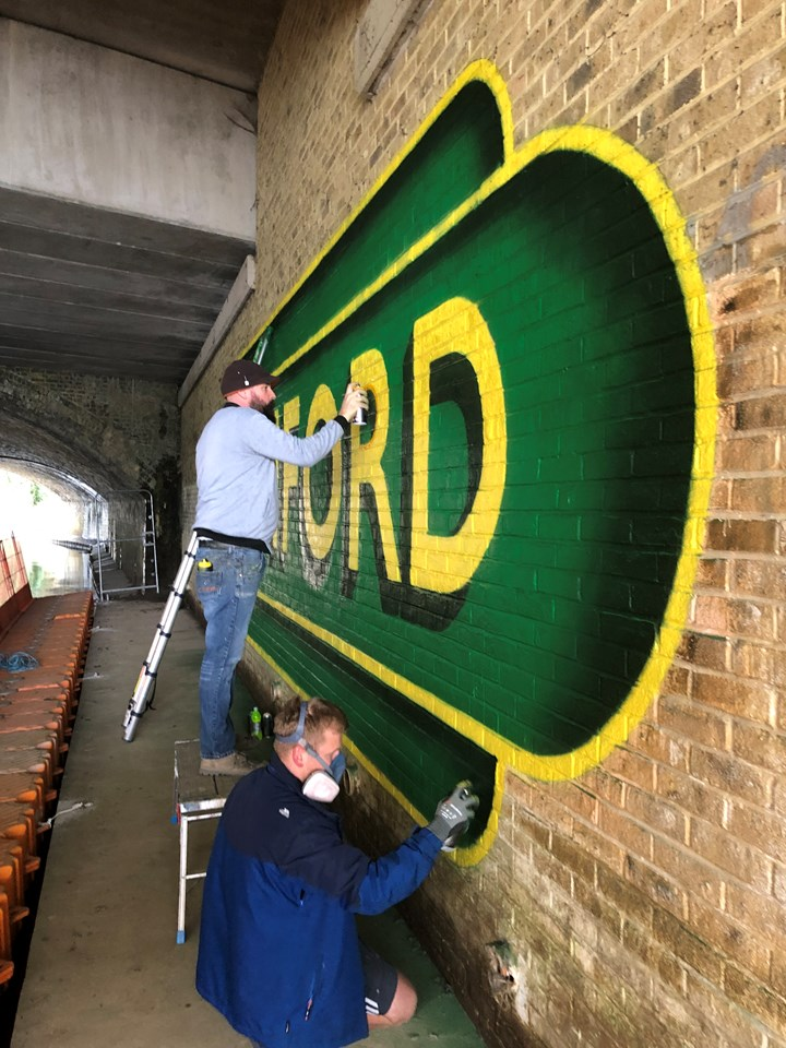 Lionel and his team completing the mural on the Ashford passageway