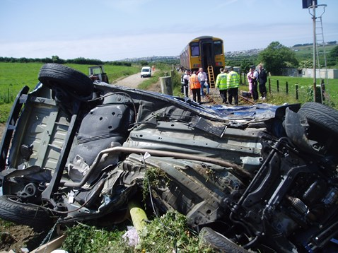 Car severely damaged after collision with train in Cornwall