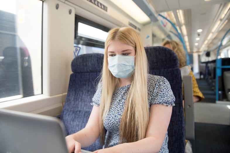 New pilot boosts already high face covering compliance on Southeastern: Passenger using WiFi