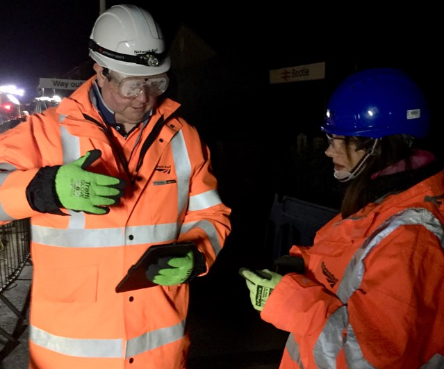 A good night's work: MP swaps sleep for track inspection during major £3m overhaul: Planning manager Adrian Brookes with Trudy Harrison MP