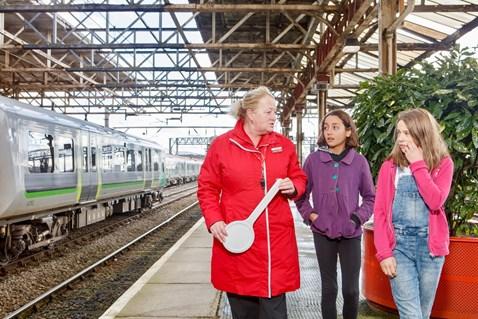 Railway Children Sleepout: Station staff leading children (models) to help