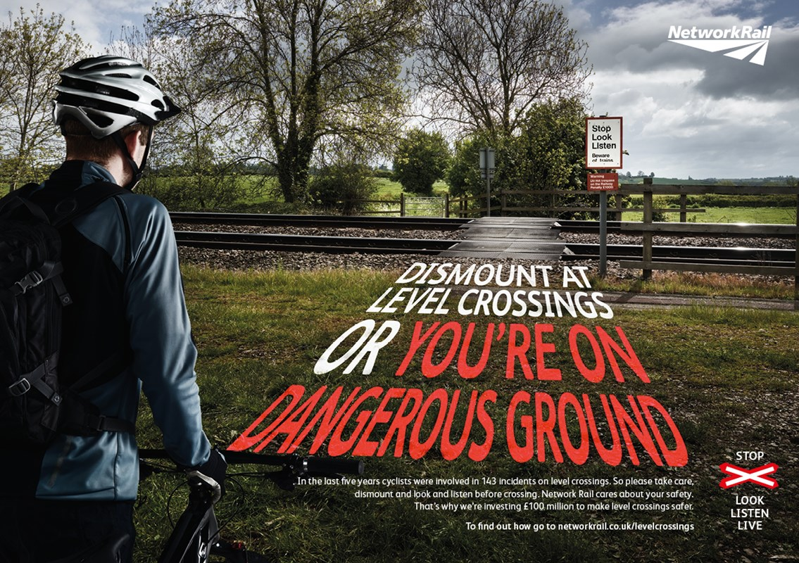 Network Rail push bike level crossing safety message: Footpath crossing cyclist poster