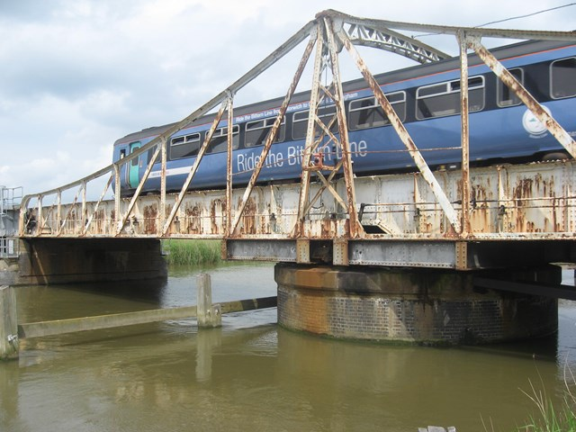 Reedham swing bridge: A National Express East Anglia train passes over Reedham swing bridge in Norfolk.