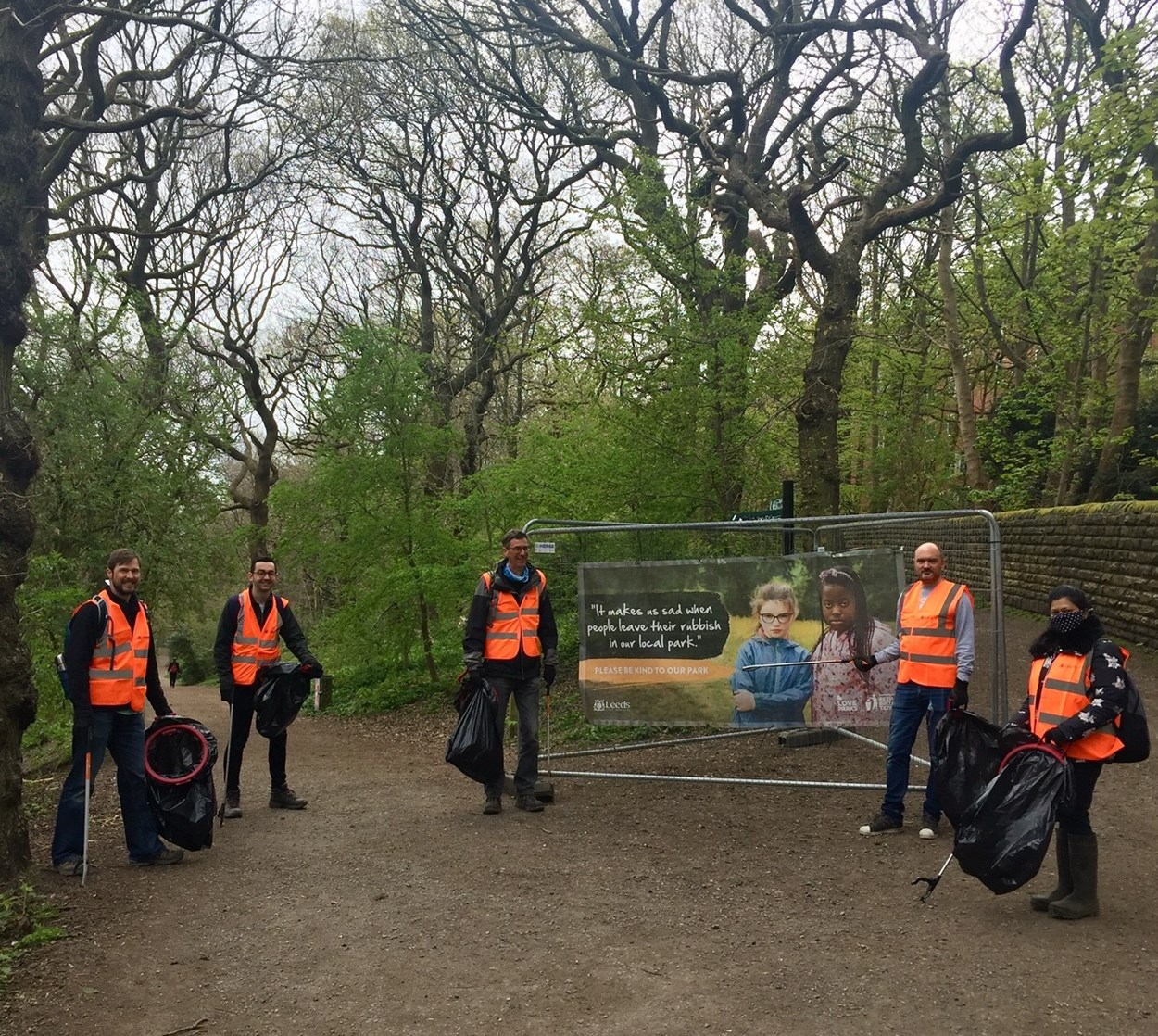 Volunteers in parks and green spaces,: A number of local organisations, businesses and teams from other Lees City Council services have added their support to the council's campaign. Here, members of the council's sustainable energy and air quality teams undertake a litter pick at Woodhouse Ridge.