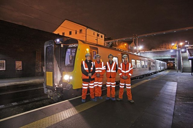 NW electrification:  the project team with the first train at Eccles