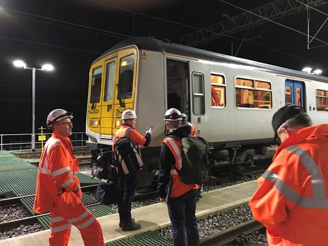 Final 100mph speed checks on newly electrified Manchester to Preston railway: Engineers about to board the final electric test train between Preston and Manchester Victoria