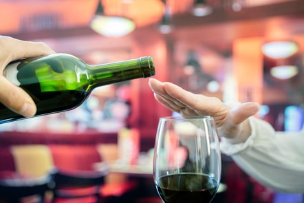 GettyImages-1281811365-hand-over-wine-glass-1024x683
