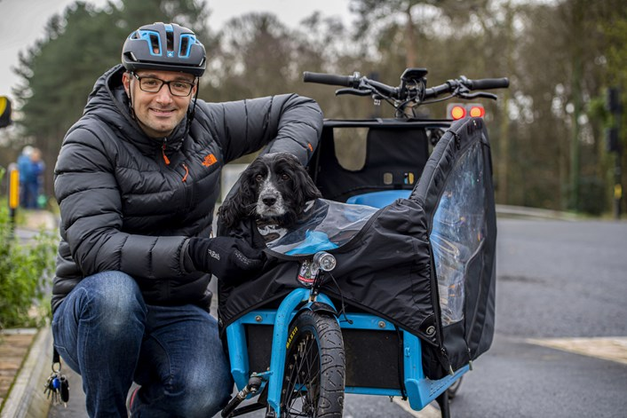 Person and dog in cycle trailer
