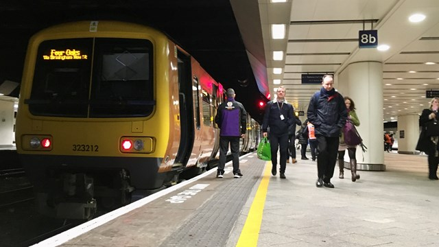 West Midlands Railway train on platform at Birmingham New Street
