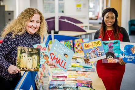 Cllrs O'Halloran and Ngongo with books to be donated to Mother Tongue Supplementary Schools