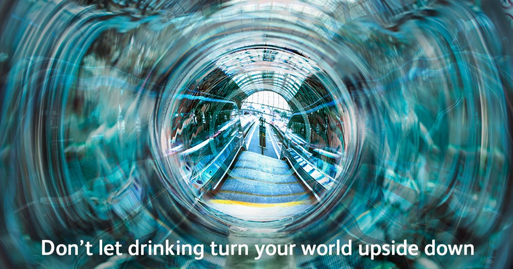 "Revellers warned to ""keep a clear head"" around the rail network over the festive season: Don't let drinking turn your world upside down poster"