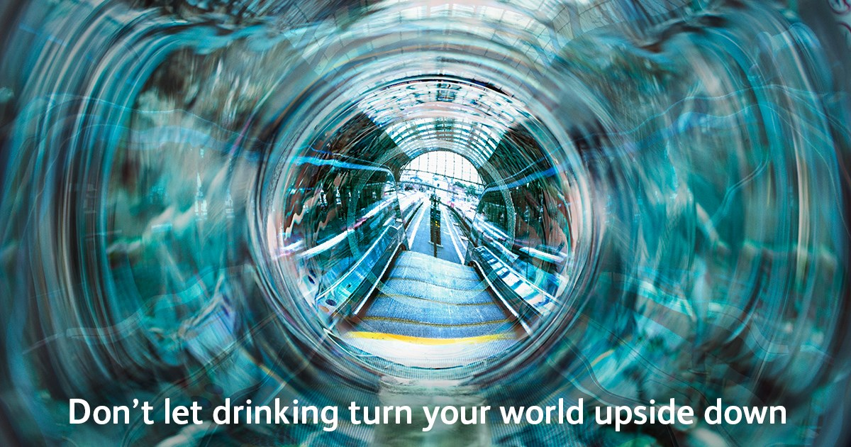 """Manchester festive revellers urged to """"keep a clear head"""" on the railway: Don't let drinking turn your world upside down poster"""