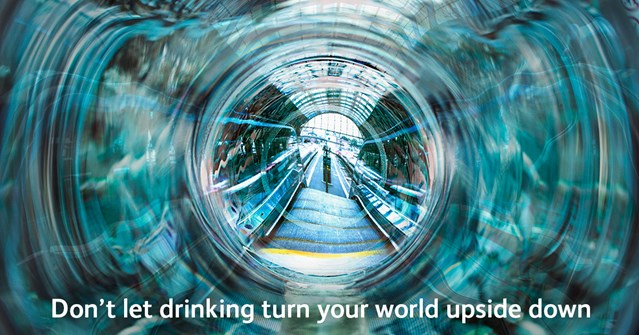 "Manchester festive revellers urged to ""keep a clear head"" on the railway: Don't let drinking turn your world upside down poster"