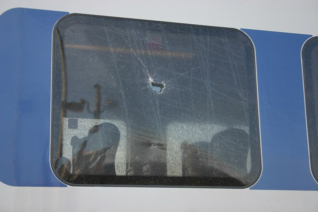 Damage caused by stone throwing: .