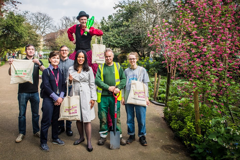 Islington in Bloom2019arrives just in time for spring: Launch of Islington In Bloom 2019 at Duncan Terrace Gardens - members of Friends of Duncan Terrace join council parks staff, Cllr Claudia Webbe, executive member for environment and transport and Jebb the Jester (on stilts)