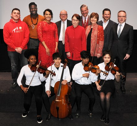 Music Education Islington launch event 1: At the launch were the Music in Secondary Schools Trust Saturday School Quartet (front row, from left) Cherie Chan, Sara Pelham, Farah Wadud and Aaliyah Lakeman, with (top row, from left) Benjamin Boukerma (Islington Youth Councillor), Jermain Jackman (chair of Islington Fair Futures Commission), Cllr Kaya Comer-Schwartz (Islington's executive member for children, young people and families), Sir Nicholas Kenyon CBE (managing director, Barbican Centre), Catherine McGuinness (policy chair, City of London Corporation), Sean Gregory (director of learning and engagement, Guildhall School and Barbican Centre), Lynne Williams (principal, Guildhall School), Mark Owen (head teacher, Gillespie Primary School) and Cllr Richard Watts (leader of Islington Council).