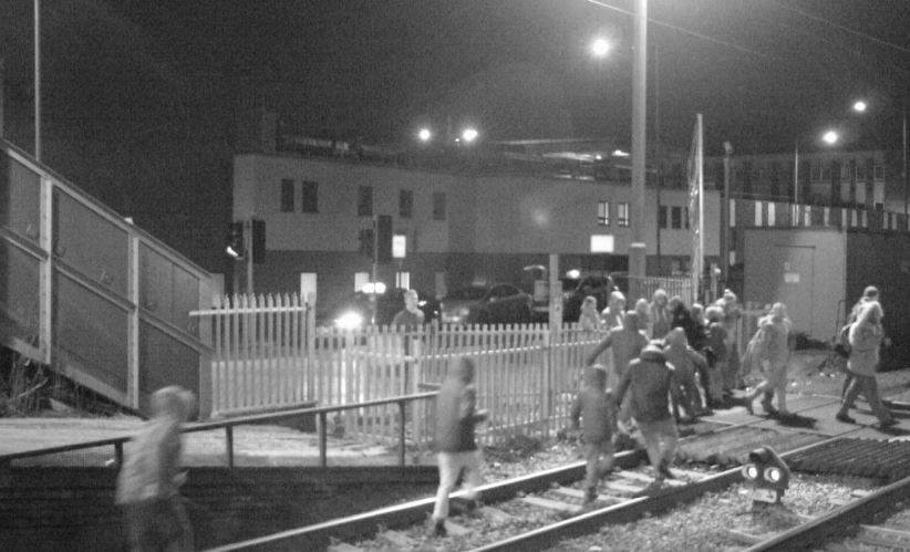 School children across Norfolk, Suffolk, Essex and Cambridgeshire warned to keep off the tracks and tune into railway safety lessons at home: People on the tracks at Grays level crossing in Essex