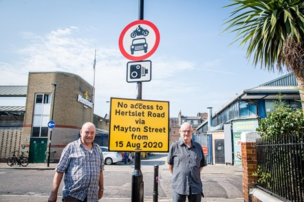 Cllr Michael O'Sullivan (pictured right) and Cllr Gary Heather (left) with new signage announcing measures to make Mayton Street greener, safer and more pleasant