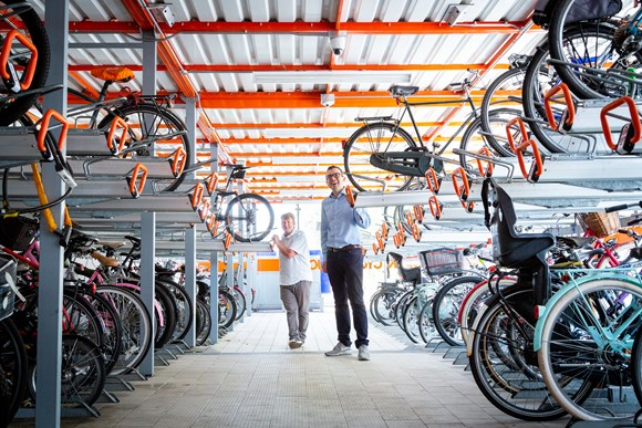 TfL Press Release - TfL announces £2.5m funding boost to meet growing demand for cycle parking: TfL Image - Will Norman and Cllr Clyde Loakes at a cycle parking hub in Walthamstow 01