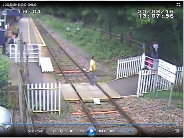 Matlock Bath - Man stands on crossing while on phone