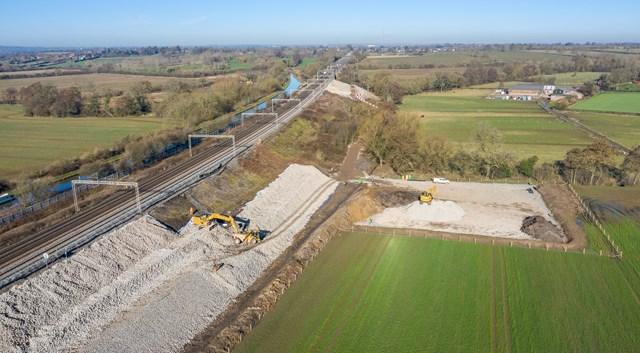 Wide drone shot showing Hopsford Hall embankment work Spring 2021