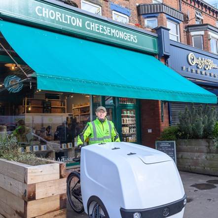 TfGM Nick from Chorlton Bike Deliveries outside cheesemongers with cargo bike