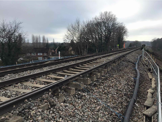 Trains suspended between Guildford, Farnham and Ash as Network Rail engineers work to fix Surrey landslip: wanborough landslip near Guildford