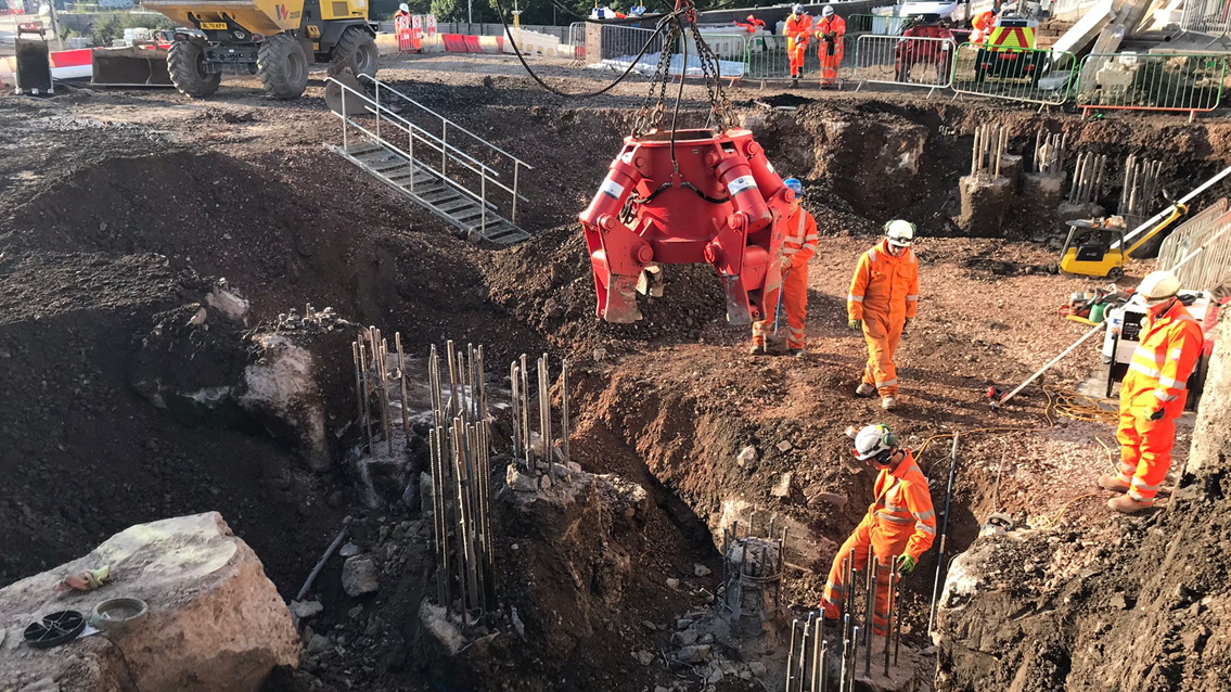 Network Rail and BAM Nuttall engineers digging out the ground underneath platform 15