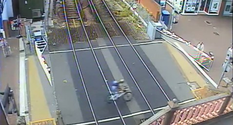 Poole High Street level crossing cyclist