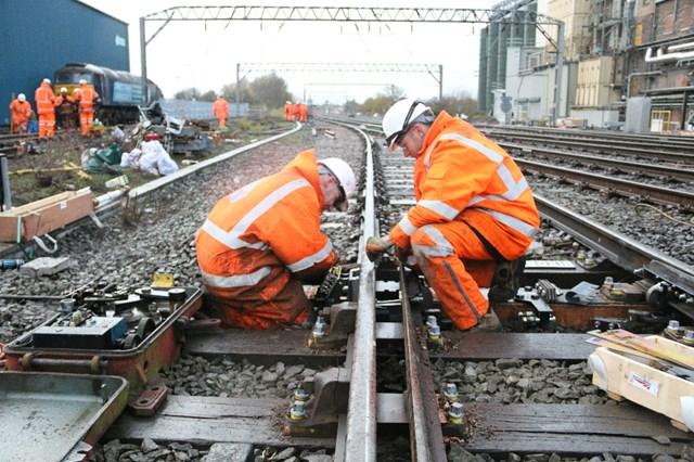 Trains running on upgraded railway between Crewe and Shrewsbury: Point Gauging Team working on resignalling between Crewe and Shrewsbury