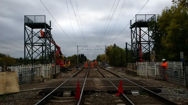 Photos show progress of new footbridge over the railway in Hertfordshire: Trinity Lane bridge construction