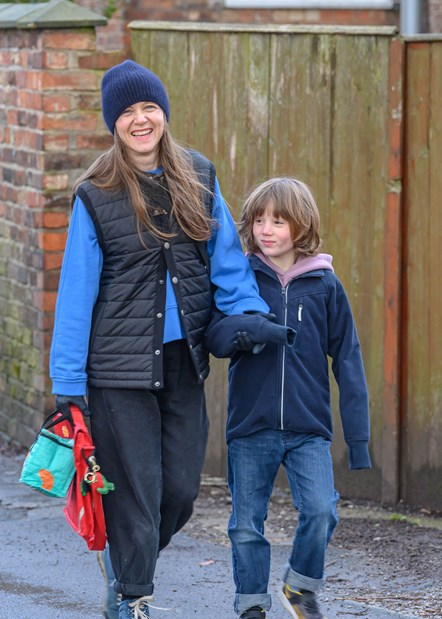TfGM mother and son walking to school through active neighbourhood