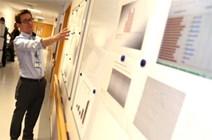 Man looking at hospital charts: From SG Flickr