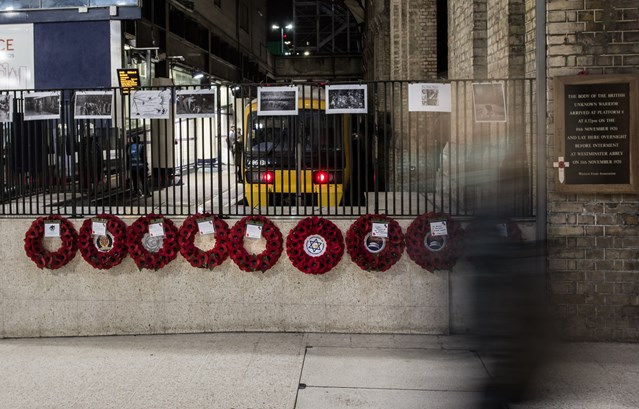 Pictures: Remembering the Unknown Warrior at Victoria Station: Commuters stream past wreaths laid in honour of the Unknown Warrior at Victoria Station
