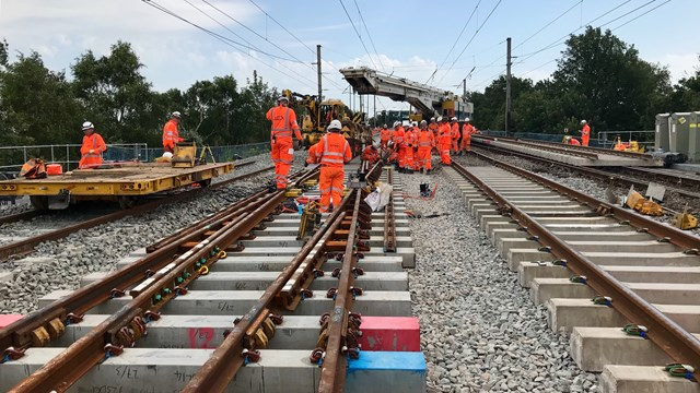Railway reopens after 16-day overhaul of key junction on West Coast main line: Workers on site during £27m renewal of Acton Grange junction