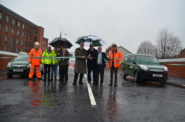 Manchester to Stalybridge electrification one step closer as Ashton-under-Lyne bridge rebuild completes over three weeks early: From left to right: Tameside Council's highways team; Cllr Peter Robinson; Danny O'Brien and Brendan McNeil from J.Murphy & Sons; and Steve Cooper from Network Rail
