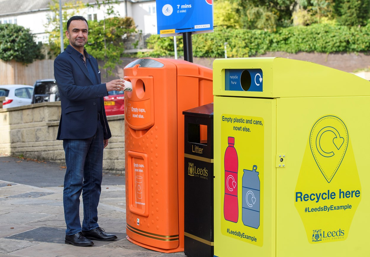 Image 2 Executive Member Cllr Rafique with the recycling-on-the-go bins