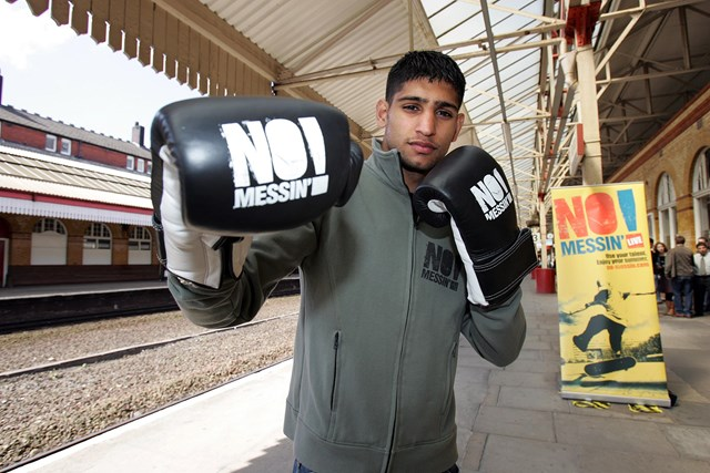 Amir Khan joins No Messin'! campaign: Amir Khan at Bolton station