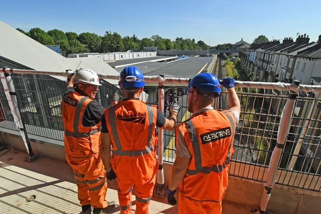 Engineers having team briefing at Twickenham station